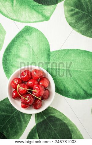Fresh Red Cherries In White Bowl As Summer Concept