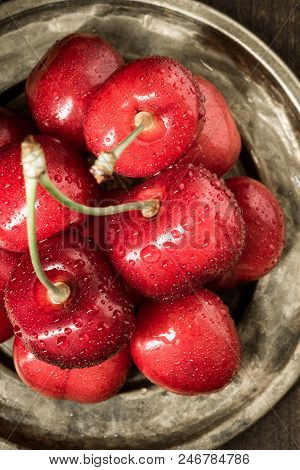 Fresh Red Cherries With Water Drops As Summer Concept
