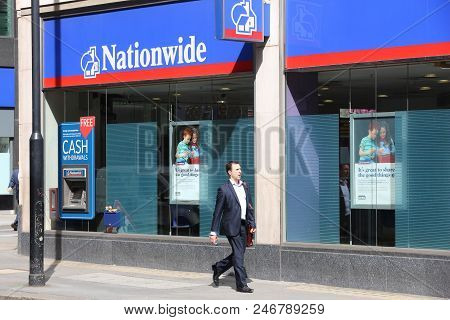 London, Uk - July 6, 2016: People Walk By Nationwide Building Society In London. Nbs Is The Largest