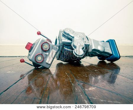 vintage bot lost his head on a old wooden floor with reflection