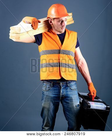 Carpenter, Woodworker, Labourer, Builder On Busy Face Carries Wooden Beams On Shoulder. Man, Handyma
