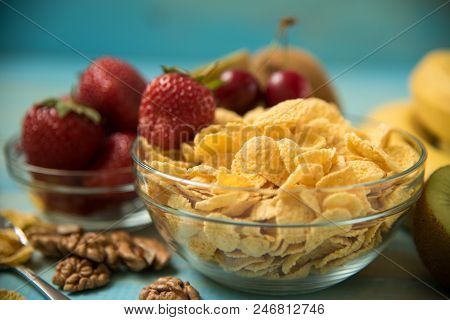 Healthy Food Background Close-up. Tasty Cornflakes In Glass Bow With Walnut And Strawberries, Lbanan