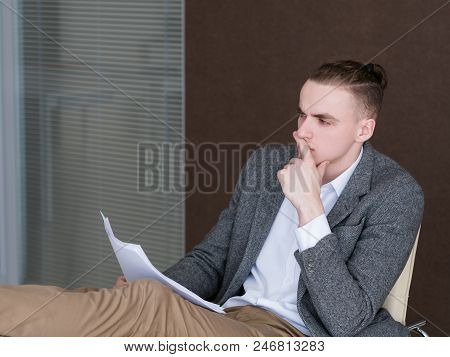 Pensive Thoughtful Business Man At Work. Contemplating Over Documents In Office. Confident Successfu