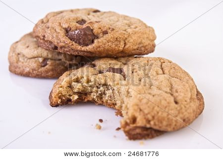 Chocolate Chip Cookies With One Half Eaten