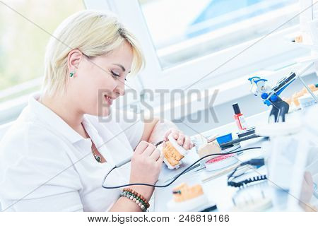 dental technician or prosthesis worker. prosthetic dentistry process