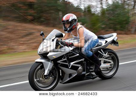 Speeding Motorcycle Woman