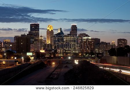 Minneapolis Skyline From 24th Street Pedestrian Bridge Overlooking 35w Interstate And Office Towers