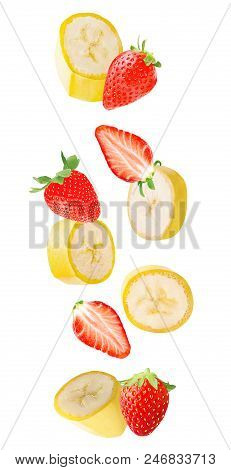 Isolated Flying Fruits. Falling Banana And Strawberry Fruits Isolated On White Background With Clipp