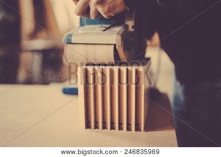 Processing Of A Furniture Part By A Machine For Polishing A Wooden Furniture Detail. Toned Image. Wo