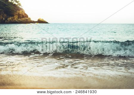 Coastline Beach On Sunny Day Background Of Ocean And Horizont Sky, Gold Sand Closeup Blur, Tourism R