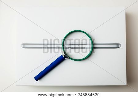 London, United Kingdom - Jan 14, 2015: Loupe Magnifying Glass On The New Apple Macbook Pro Laptop Co