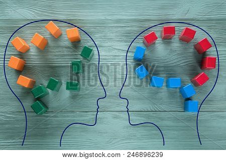 The Concept Of Rational And Irrational Thinking Of Two People. Heads Of Two People With Colourful Sh