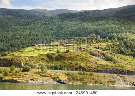 Landscape With Naeroyfjord, Mountains And Traditional Houses In Norway.