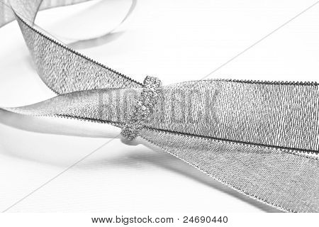grey ribbon and diamond ring