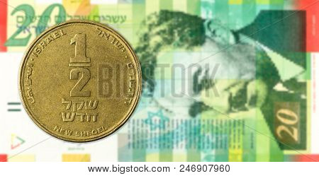 0,5 Shekel Coin Against 20 Israeli New Shekel Bank Note Obverse