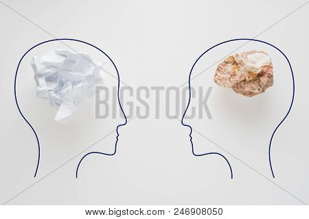 Heads Of Two People With Crumpled Paper Brain Shape And Stone Brain Shape. Two People With Different