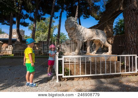 Side, Turkey - June 11, 2018: Little tourists at the ancient museum of Side in Turkey. Side  is an ancient Greek city on the southern Mediterranean coast of Turkey.