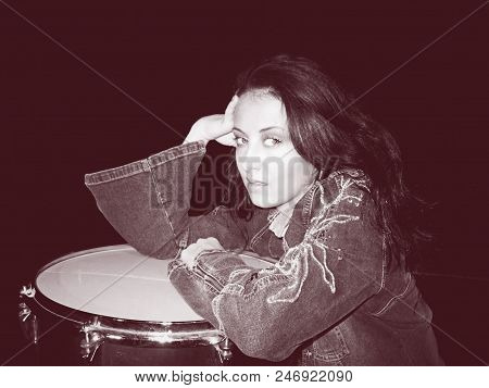 Vintage Drummer Woman. Woman Pose At Vintage Drum In Jacket. Vintage Fashion Jeans Style. Woman With