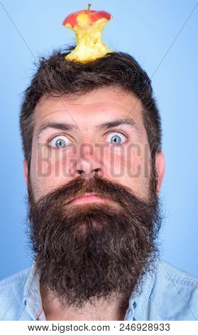 Hipster Shocked Face With Apple Stump Target On Head Blue Background, Close Up. Weight Loss Goal. Ma