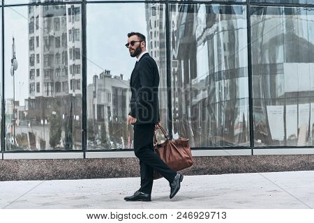 Pure Confidence. Full Length Of Young Man In Full Suit Looking Away While Walking Outdoors