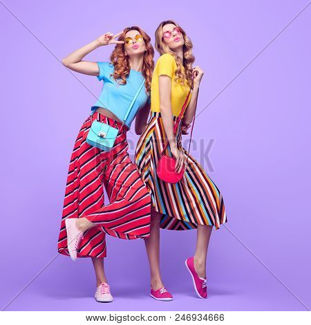 Two Playful Sisters Twins With Kiss Face Expression. Young Beautiful Girls Having Fun In Studio On P