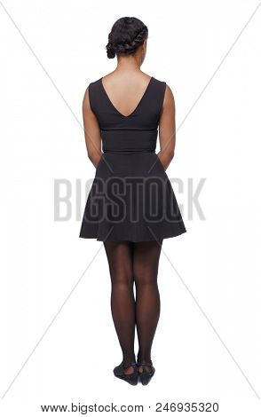 Back view of an African-American woman in a brown dress. girl  watching. Rear view people collection.  backside view of person. Isolated over white background