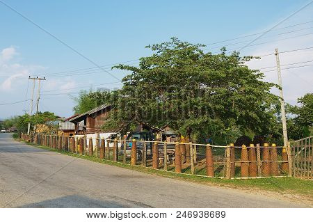 Phonsavan, Laos - April 19, 2012: View To The Fence Made Of American Unexploded Bombs Collected Afte