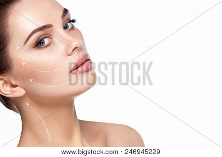 Portrait Of Beautiful Woman With Perfect Skin Of The Face, With Arrows On Face, Concept Of Lifting S