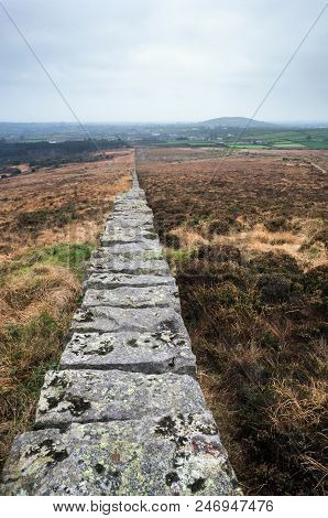 A Wall Near Spelga Dam Leading Towards The Moune Mountains In Northern Ireland.
