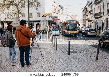 Portugal, Lisbon, May 1, 2018:the Photographer Takes Pictures Of The City Landscape And Vehicles Mov
