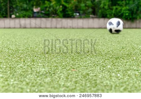 Football Lawn, Ball In Background. Soccer Closeup Detail Wallpaper Texture.