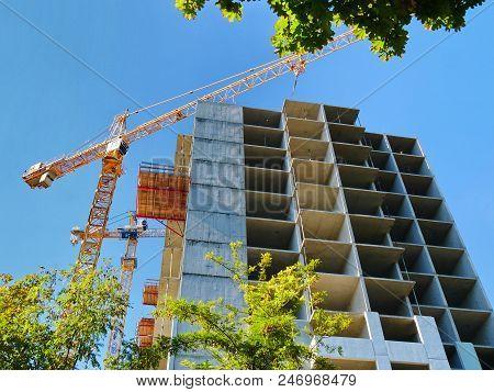 Construction Site. Conctruction Building. Construction Crane Near Building Under Construction Agains