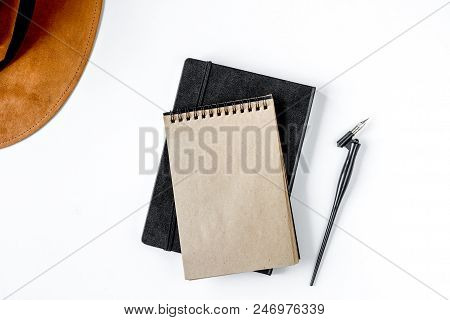 Writer Workplace With Tools, Copybook And Pen On White Table Background Top View