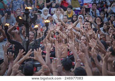 Bali, Indonesia - April 19: Tourists Watch Traditional Balinese Kecak Dance At Uluwatu Temple On Bal