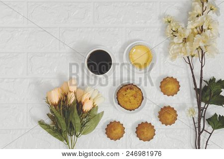 Coffee and cakes on white brick background. Rustic nostalgia cozy breakfast. poster