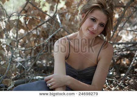 Woman Sitting In The Forest