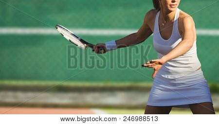 Digital composite of Mid-section of female tennis player