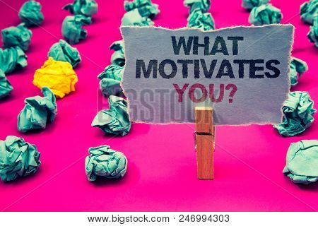 Writing Note Showing  What Motivates You Question. Business Photo Showcasing Passion Drive Incentive