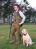 Young Man with his dog at Moyness Shooting for Pheasant. poster