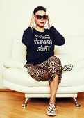 pretty stylish african american big mama woman well dressed. swag relax at home, leopard print on clothers. fashion look poster
