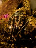 Gilded Gold leaf covered on golden Buddha statue in the Thai temple poster