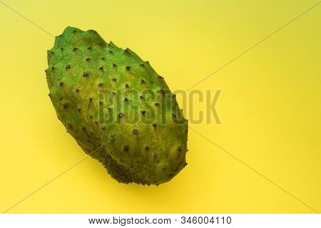 Annona Muricata Or Graviola. Soursop Fruit, Sugar Sweet Apple Or Custard Milk Apple On Yellow Backgr
