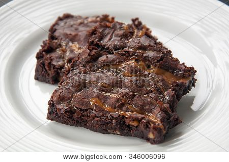 Brownies With Caramel On White Plate.  Closeup Of Homemade Baked Goods, This Chocolate Dessert Of Cu