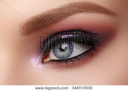 Beautiful Closeup Eye Make-up With Purple Glitter Shadows. Fashion Celebrate Makeup, Clean Skin, Per