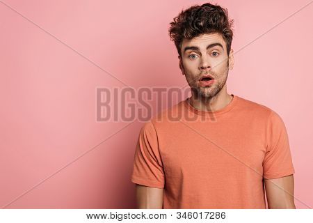 Discouraged Young Man Looking At Camera On Pink Background