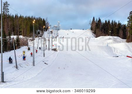 Jyvaskyla, Finland, January 4: Residents Of The City Take A Lift And Descend A Snow-covered Slope At