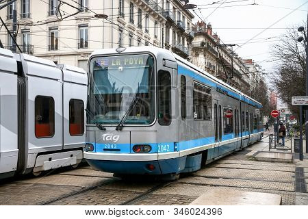 Grenoble, France - March 14, 2019: Grey And Blue Articulated Tramway Alstom Tfs2 In The City Street.