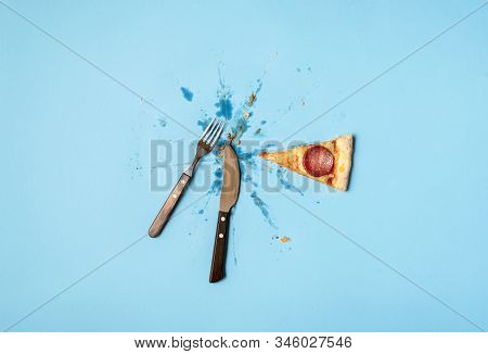 Eating Pizza Concept With Slice Of Pizza Salami, Grease And Cutlery On Blue Background. Flat Lay Of