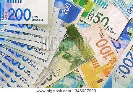 Israeli Money Stack Of The New Israeli Money Bills (banknotes) Of 50, 100 And 200 Shekel. New Israel