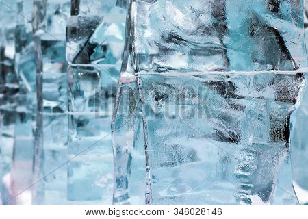 Ice Texture. The Abstract Background Of Ice Structure. Ice Sculpture Close Up. Blue Transparent Ice